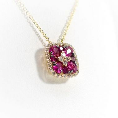 La Masters Couture 14 KT Gold Natural Ruby  Pendant in Black Setting W/ Accent Diamond Center and Halo